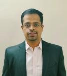 Dr. Mohan B